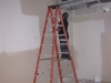 More drywall work to close up walls after electrical work