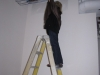 Wendy testing out an 8 foot ladder to make sure she can reach 12 foot ceiling to change light bulbs!